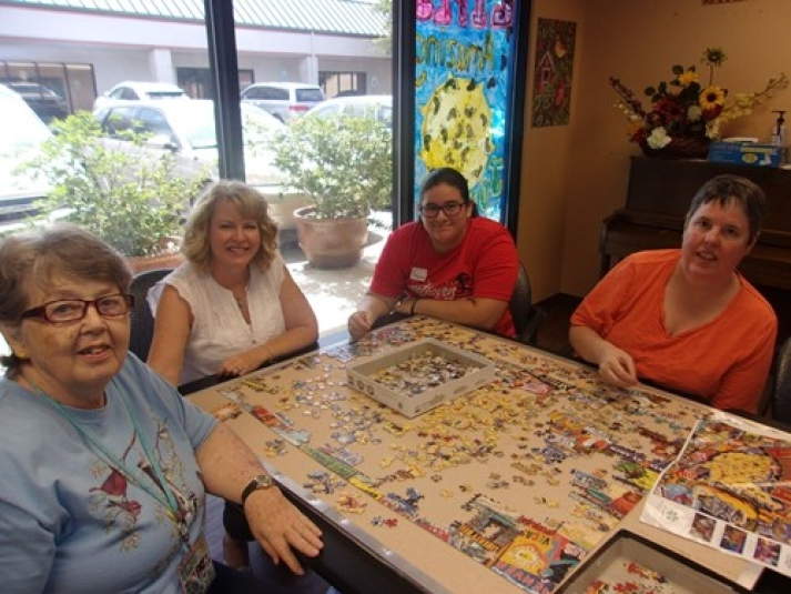 Elderly playing with a puzzle