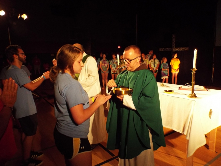 girl receiving communion