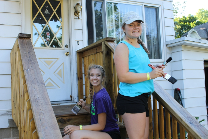 girls working on porch steps