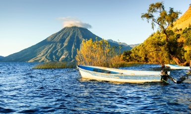 Fishing Boat by a Volcano