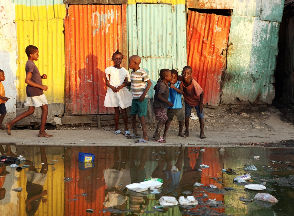 Children in front of flooded street